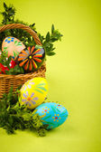 Beautiful decorative easter eggs in a basket — Stock Photo
