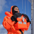 Seaman in immersion suit and in life jacket — Stock Photo