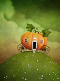 Pumpkin carriage on green hill — Photo