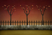 Spring evening street with fence, trees and the red sky — Stock Photo