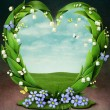 Frame with flowers in shape of heart — Stock Photo #41637551