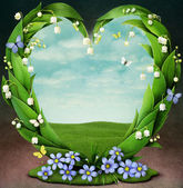 Frame with flowers in shape of heart — Stock Photo