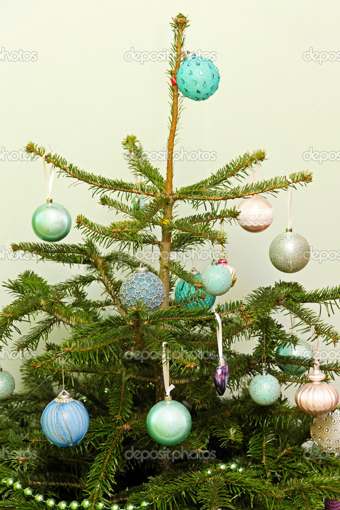Top of Christmas tree with bunch of shiny ornaments — Stock Photo #13633493