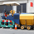 Asphalt paving machine - Stock Photo