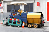 Asphalt paving machine — Stock Photo