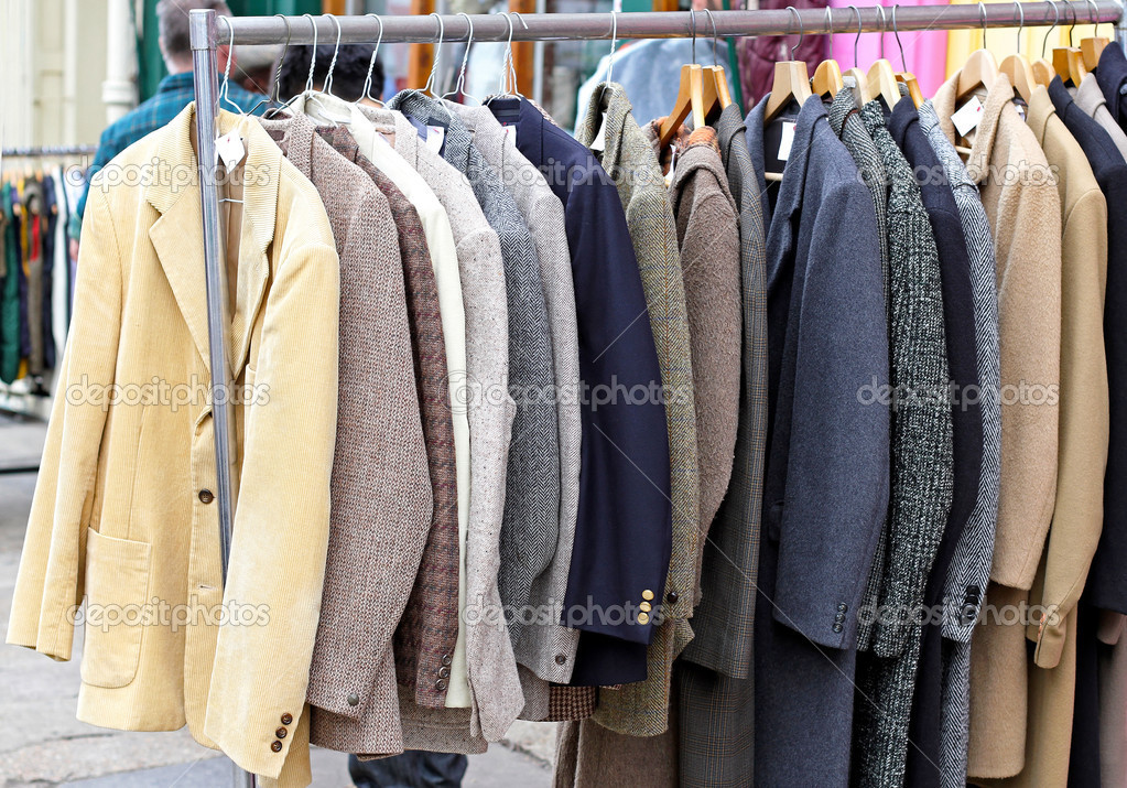 Second hand retro suits and jackets at rail — Zdjęcie stockowe #14136567