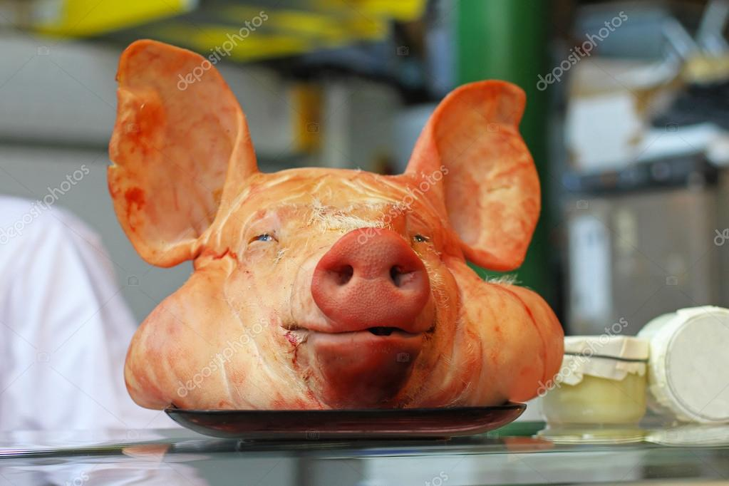 Decapitated pig head with big ears in butcher shop — Stock Photo #14611749