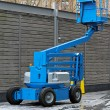 Articulating boom lift - Stock Photo