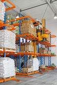 Stacker in warehouse — Stock Photo