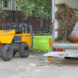 Stock Photo: Skip Loading Dumper