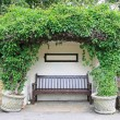 Bench in garden - Stock Photo