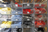 T shirts in shelf — Stock Photo