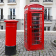 Telephone and post box — Stock Photo