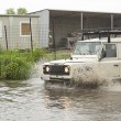 Постер, плакат: Land Rover in flood