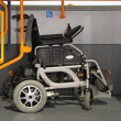 Постер, плакат: Wheelchair in bus