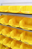 Yellow plastic racks — Stockfoto