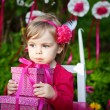 Little girl with birthday presents — Stock Photo