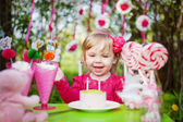 Happy girl with birthday cake — Stock Photo
