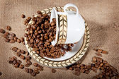 A cup with coffee beans — Stock Photo