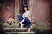 Young woman wit the dog — Stock Photo