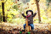 Little boy in the autumn forest — Stock Photo