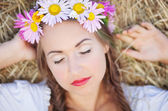 Girl with flower wreath outdoors — Stock Photo