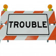 Trouble Word on Construction Barrier Barricade — Stock Photo