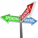 Spending Saving Budget Three Road Signs Arrows — Stock Photo