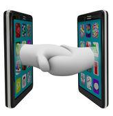 Two Smart Phones Sharing Data Shaking Hands — Stock Photo