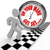 En sus marcas listos persona a competir con la hora del reloj — Foto de Stock