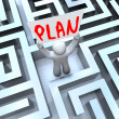 Plan Man Holding Sign in Maze Labyrinth - Stock Photo