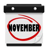 Kalendarz ścienny słowo listopada zmienić harmonogram miesiąca — Zdjęcie stockowe