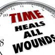 Time Heals All Wounds Clock Saying - Forgiveness of Disputes - Stock Photo