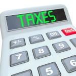 税-税务会计的计算器上的字 — 图库照片