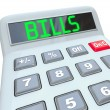 Bills - Word on Calculator for Payment of Expenses — Stock Photo