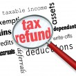 Searching for a Tax Refund - Magnifying Glass - Stock Photo
