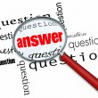 Stock Photo: Questions and Answers - Magnifying Glass on Words