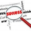 Stock Photo: Finding Success Amid Failure - Magnifying Glass