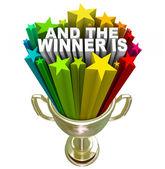 Y el ganador es premio trofeo oro — Foto de Stock