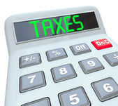 налоги - слово на калькулятор для налогового учета — Стоковое фото