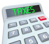 Belastingen - woord op rekenmachine voor fiscale accounting — Stockfoto