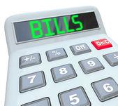 Facturas - palabra en calculadora para el pago de los gastos — Foto de Stock