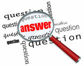 Questions and Answers - Magnifying Glass on Words — Stock Photo