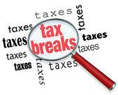 Jak znaleźć ulgi podatkowe - szkło powiększające — Zdjęcie stockowe