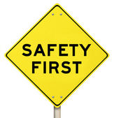 Yellow Warning Sign - Safety First - Isolated — Stock Photo