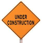 Orange Warning Sign - Under Construction — Stock Photo