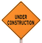 Orange Warning Sign - Under Construction — Stock Photo