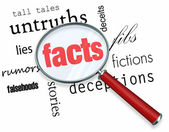 Searching for Facts vs. Fiction - Magnifying Glass — 图库照片