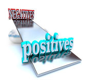 Weighing the Positives vs Negatives — Stock Photo