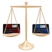 Credit Vs Debit Card - Weighing on Scale — Stock Photo